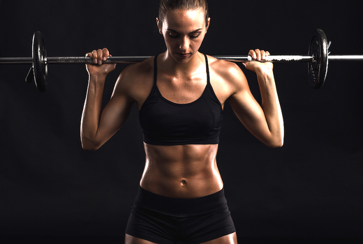 fit women lifting a weight